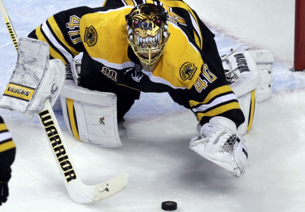 Bruins goalie Tuukka Rask pounces on a loose puck during the second period. (Charles Krupa/AP)