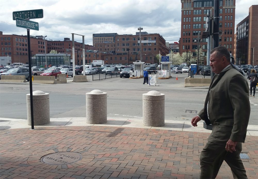 Former Probation Commissioner John O'Brien leaves the Moakley Courthouse Monday, May 5 after his corruption trial began. (State House News Service)