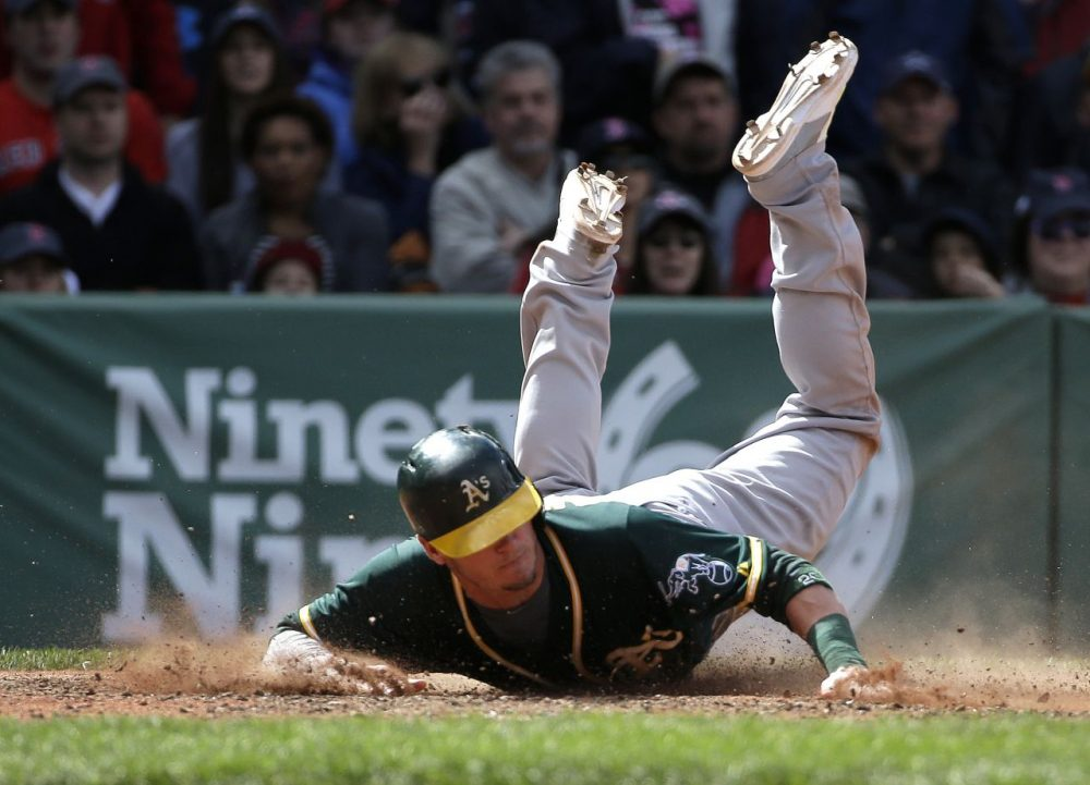 Oakland Athletics' Josh Donaldson slides home to score on a hit by Yoenis Cespedes in the sixth inning. (Steven Senne/AP)