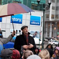 Author and journalist Matt Taibbi speaks to a crowd of Occupy Wall Street protestors after a march on the offices of pharmaceutical giant Pfizer, Wednesday, Feb. 29, 2012, in New York. (John Minchillo/AP)