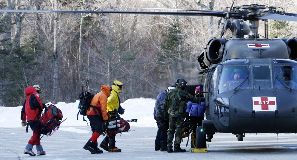 In this Jan. 22, 2007 file photo, a search-and-rescue team boards a helicopter to head to the top of Mount Lafayette to look for a missing hiker in Franconia, N.H.  (Jim Cole/AP)