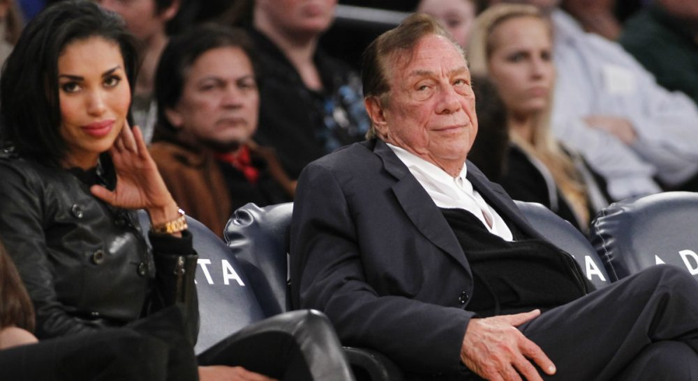 Los Angeles Clippers owner Donald Sterling, right, and V. Stiviano, left, watch the Clippers play the Los Angeles Lakers during an NBA preseason basketball game in Los Angeles on Monday, December 19, 2011. (Danny Moloshok/AP)
