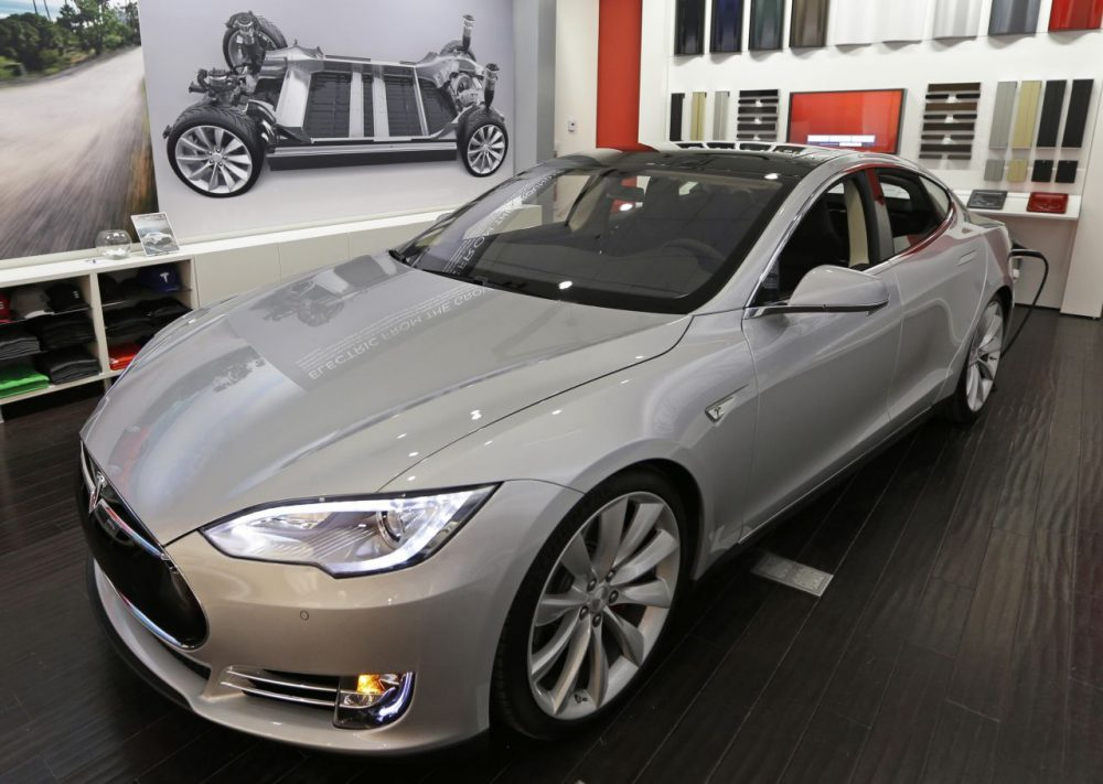 The Massachusetts State Auto Dealers Association wants to block the way California electric-car maker Tesla sells its automobiles. (Al Behrman/AP)