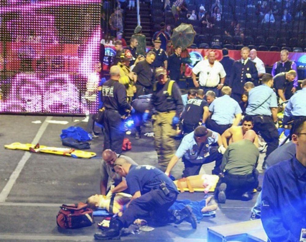 First responders asses performer injuries after a platform collapsed during an aerial hair-hanging stunt at a Ringling Brothers and Barnum and Bailey Circus performance in Rhode Island in May. (Rose Viveiros/AP)