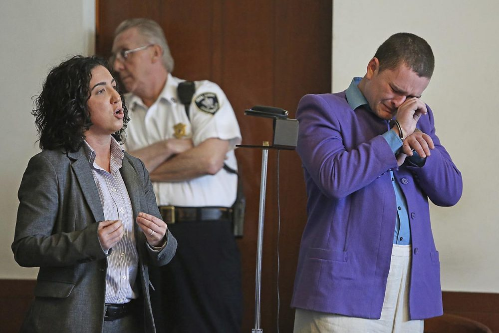 Kevin Edson cries during a hearing as he stands beside his attorney, Shannon Lopez, left, in Municipal Court last month. (Boston Herald/John Wilcox/AP/Pool)