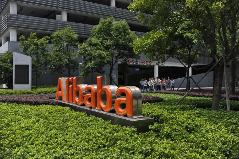 Chinese workers walk out from the Alibaba head office building in Hangzhou, in eastern China's Zhejiang province on May 21, 2012. (STR/AFP/GettyImages)