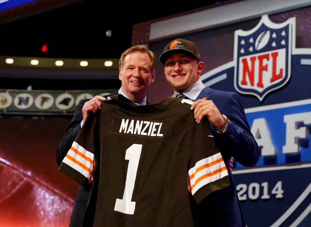 Johnny Manziel poses with Commissioner Goodell after being selected 22 in the NFL Draft. (Elsa/Getty Images)