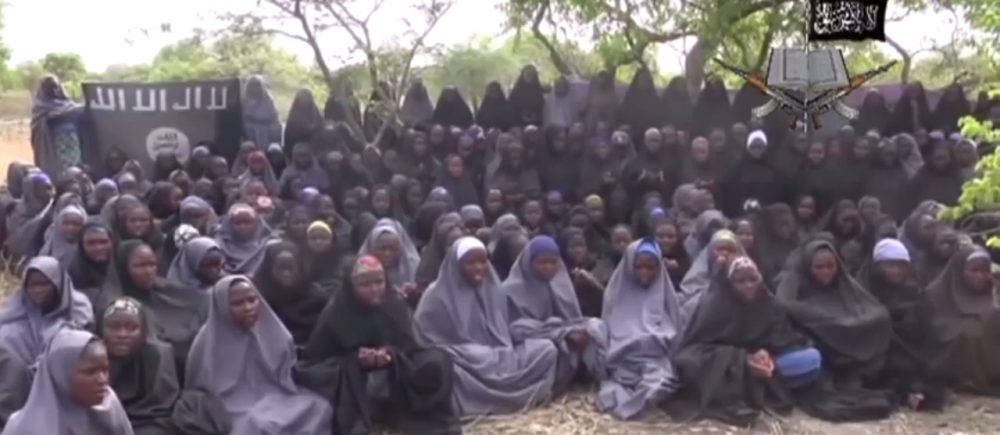 The latest video released by Boko Haram of the kidnapped Nigerian schoolgirls shows the girls dressed in full hijab and chanting passages from the Koran. (Screenshot)