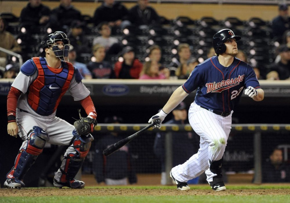 Minnesota Twins' Chris Parmelee watches his two-run home run in front of Boston Red Sox catcher A.J. Pierzynski. (AP/Craig Lassig)