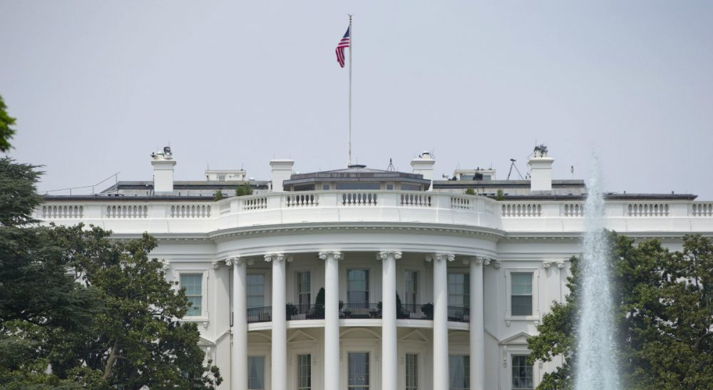"""Clean energy is the latest issue to be sucked into the """"us-against-them"""" vortex. In this photo, a bevy of solar panels blankets the roof of the White House, Friday, May 9, 2014. Technicians just finished installing the panels at the nation's most famous address. (Pablo Martinez Monsivais/AP)"""