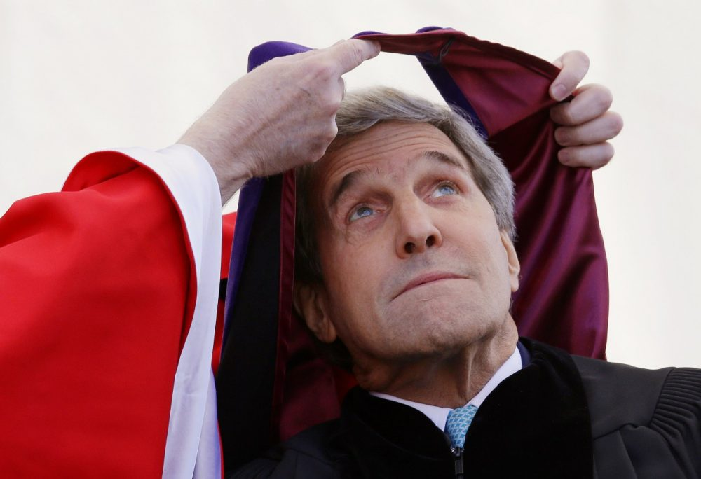 Secretary of State John Kerry is hooded by Boston College President William Leahy during the Boston College commencement ceremony. (Stephan Savoia/AP)