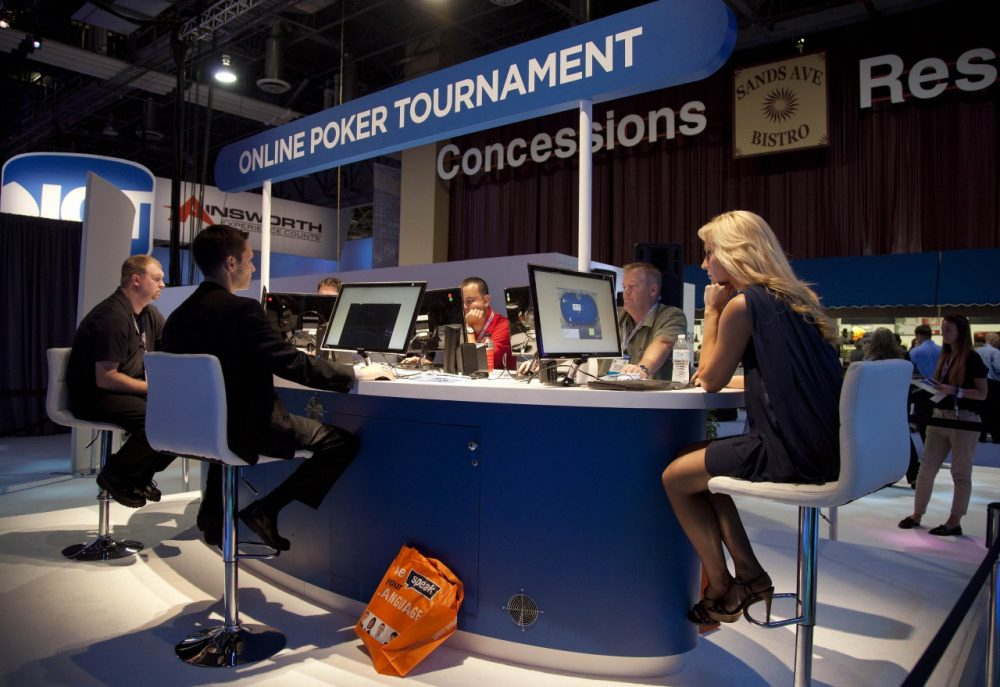 Casino industry representatives play in a mock online tournament during the G2E conference. (Julie Jacobson/AP)