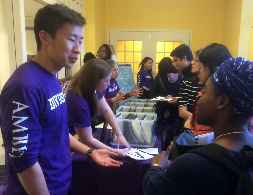 Amherst College diversity interns welcome a group of admitted students to campus on April 12. (Fred Thys/WBUR)