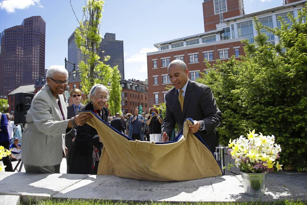 Gov. Deval Patrick helps unveil a plaque during a ceremony to honor Zipporah Potter Atkins, the first African-American to purchase property in Boston. (Stephan Savoia/AP)