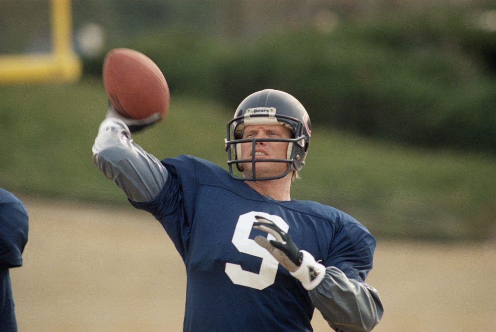Chicago Bears quarterback Jim McMahon limbers up in a passing drill at the Atlanta Falcons training camp at Suwanee, Ga., Jan. 6, 1989. (Curtis Compton/AP)