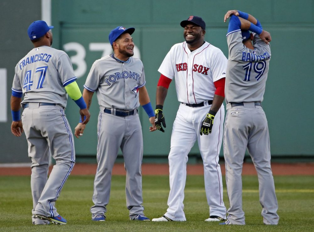 Blue Jays Red Sox Baseball Boston Red Sox's David Ortiz laughs in the outfield with Toronto Blue Jays' Juan Francisco (47), Melky Cabrera, middle, and Jose Bautista (19). (AP/Elise Amendola)
