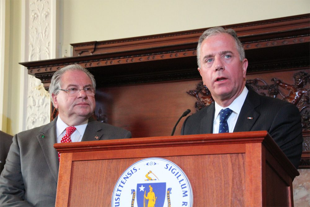 Public Safety Committee Co-Chairman Rep. Hank Naughton appears with House Speaker Robert DeLeo at the Tuesday morning unveiling of the House's anti-gun violence bill. (State House News Service)