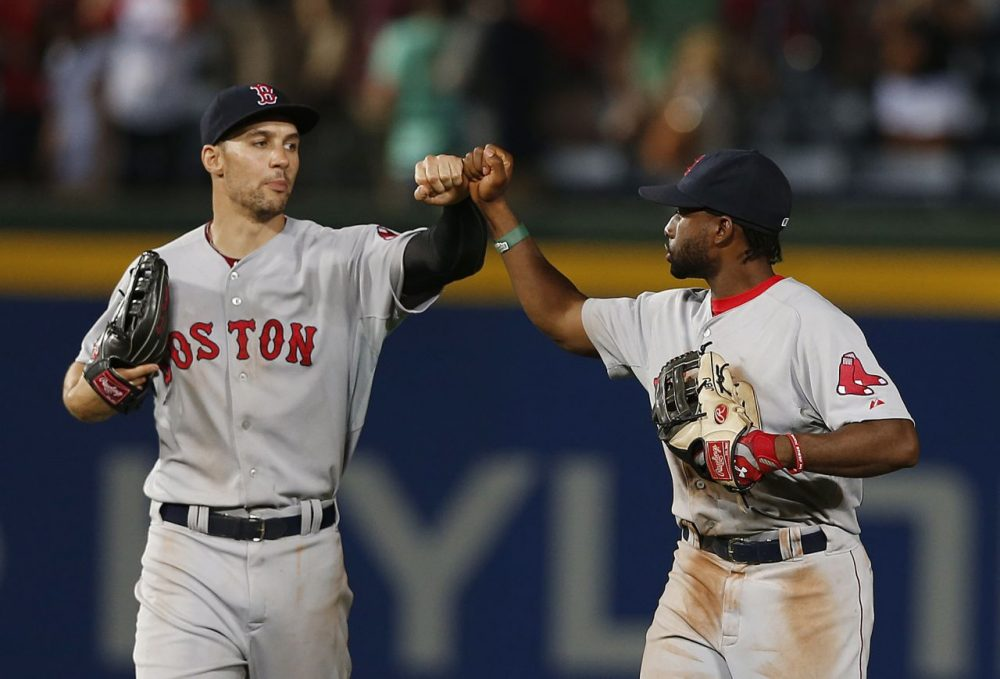 Boston Red Sox left fielder Grady Sizemore, left, and center fielder Jackie Bradley Jr. (25) celebrate after the Red Sox defeated the Atlanta Braves. (AP/John Bazemore)