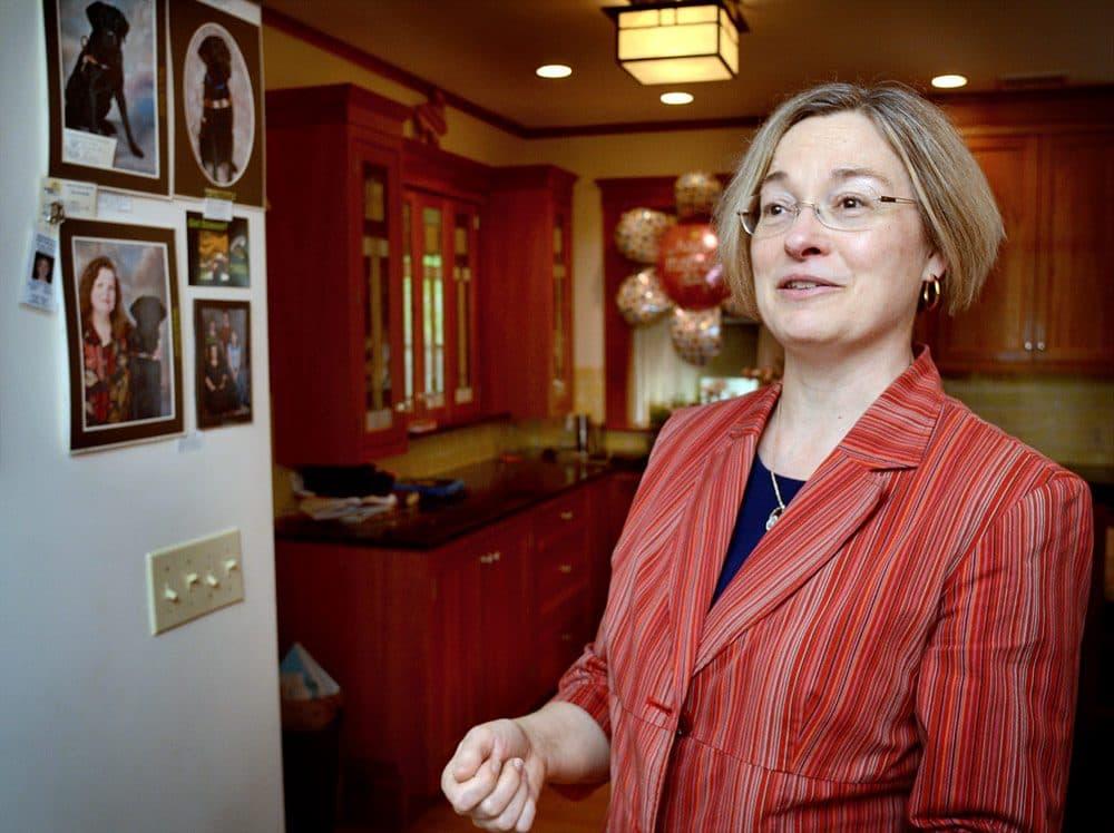 Michelle Binzel, 55, of Lexington, is an unemployed management professor. (Robin Lubbock/WBUR)