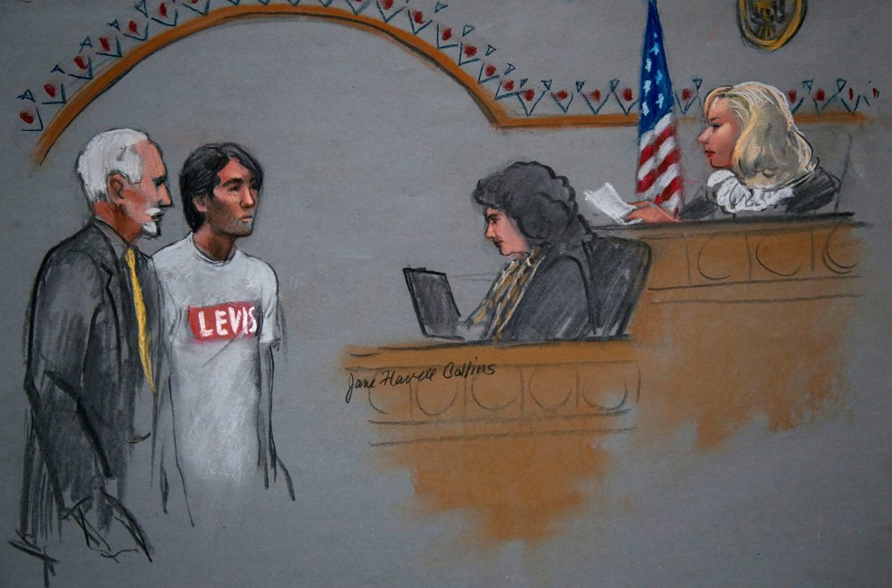 In this courtroom sketch, Khairullozhon Matanov, second from left, with attorney Paul Glickman, left, appears in federal court before Magistrate Judge Marianne Bowler Friday in Boston. (Jane Flavell Collins/AP)
