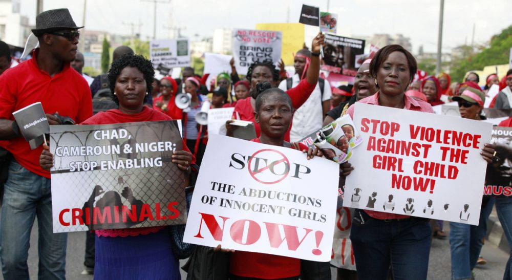 "In this Monday, May 5, 2014 photo, women attend a demonstration in Lagos, Nigeria calling on the government to rescue kidnapped school girls from Chibok government secondary school. The plight — and the failure of the Nigerian military to find them — has drawn international attention to an escalating Islamic extremist insurrection that has killed more than 1,500 so far this year. Boko Haram, the name means ""Western education is sinful,"" has claimed responsibility for the mass kidnapping and threatened to sell the girls. (Sunday Alamba/AP)"