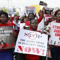 """In this Monday, May 5, 2014 photo, women attend a demonstration in Lagos, Nigeria calling on the government to rescue kidnapped school girls from Chibok government secondary school. The plight — and the failure of the Nigerian military to find them — has drawn international attention to an escalating Islamic extremist insurrection that has killed more than 1,500 so far this year. Boko Haram, the name means """"Western education is sinful,"""" has claimed responsibility for the mass kidnapping and threatened to sell the girls. (Sunday Alamba/AP)"""