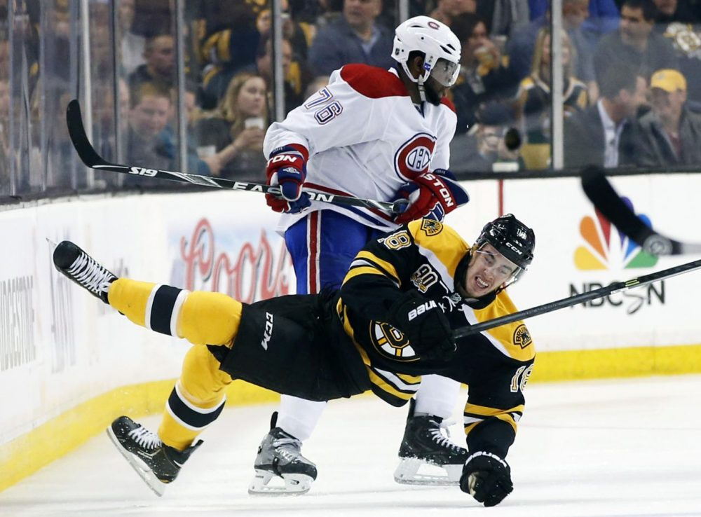Canadiens defenseman P.K. Subban checks Bruins right winger Reilly Smith during the first period of Game 1 Thursday. (Elise Amendola/AP)
