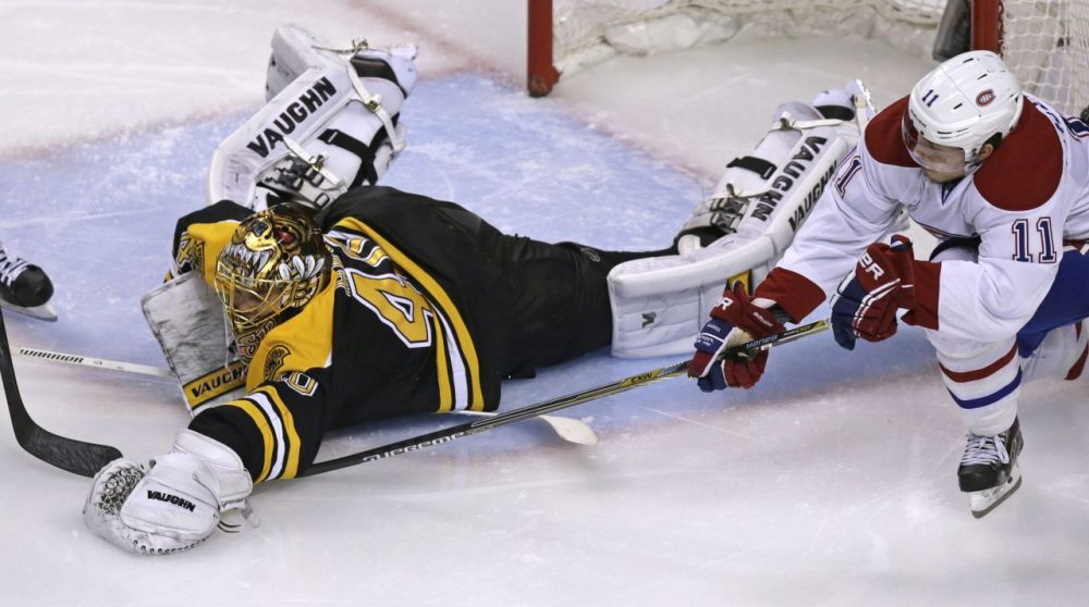 Bruins goalie Tuukka Rask (40) dives out of the crease to cover the puck while pressured by Montreal Canadiens right wing Brendan Gallagher (11) during the second period  in Boston, Saturday. (Charles Krupa/AP)