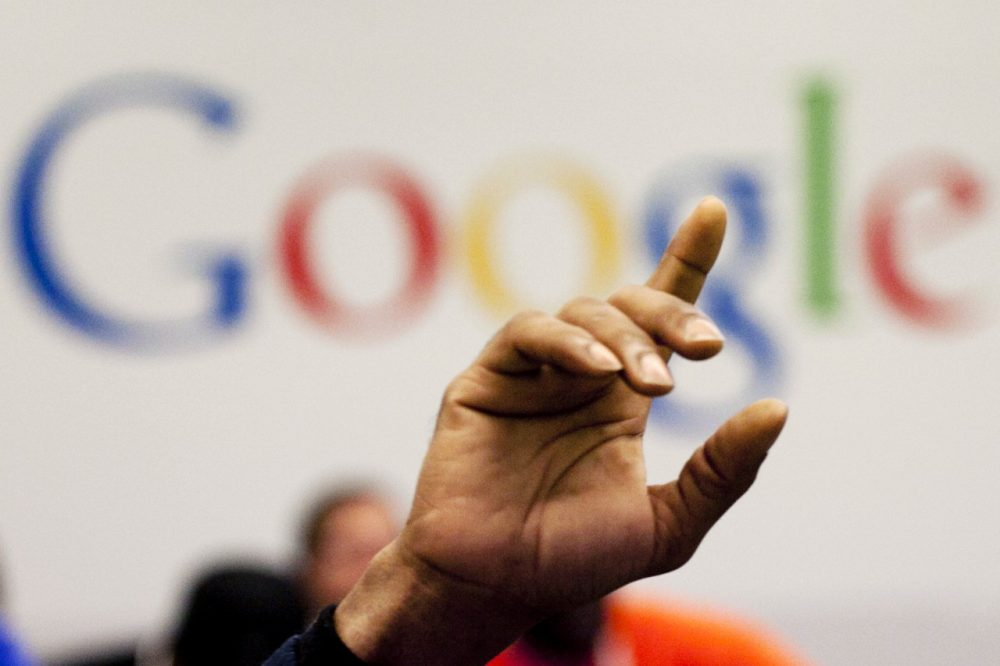 In this Oct. 17, 2012, file photo, a man raises his hand during at Google offices in New York. People should have some say over the results that pop up when they conduct a search of their own name online, Europe's highest court said Tuesday, May 13, 2014. (AP)