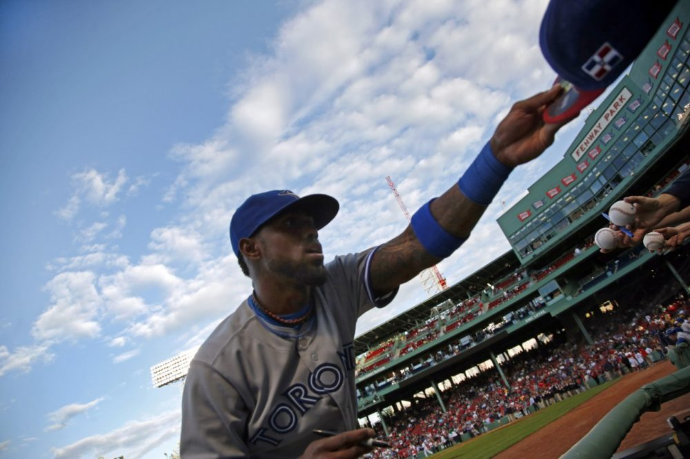 Toronto Blue Jays shortstop Jose Reyes signs autographs prior to a baseball game against the Boston Red Sox at Fenway Park in Boston, Tuesday, May 20, 2014. (AP)