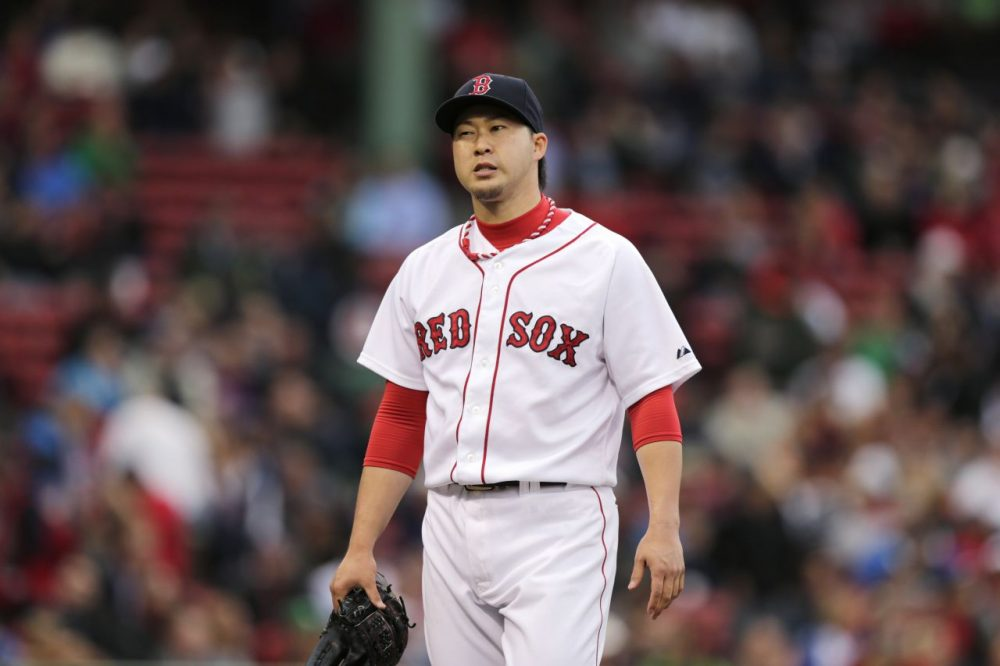 Boston Red Sox relief pitcher Junichi Tazawa after pitching to the Toronto Blue Jays during the ninth inning of a baseball game at Fenway Park, Thursday, May 22, 2014, in Boston. (Charles Krupa/AP)