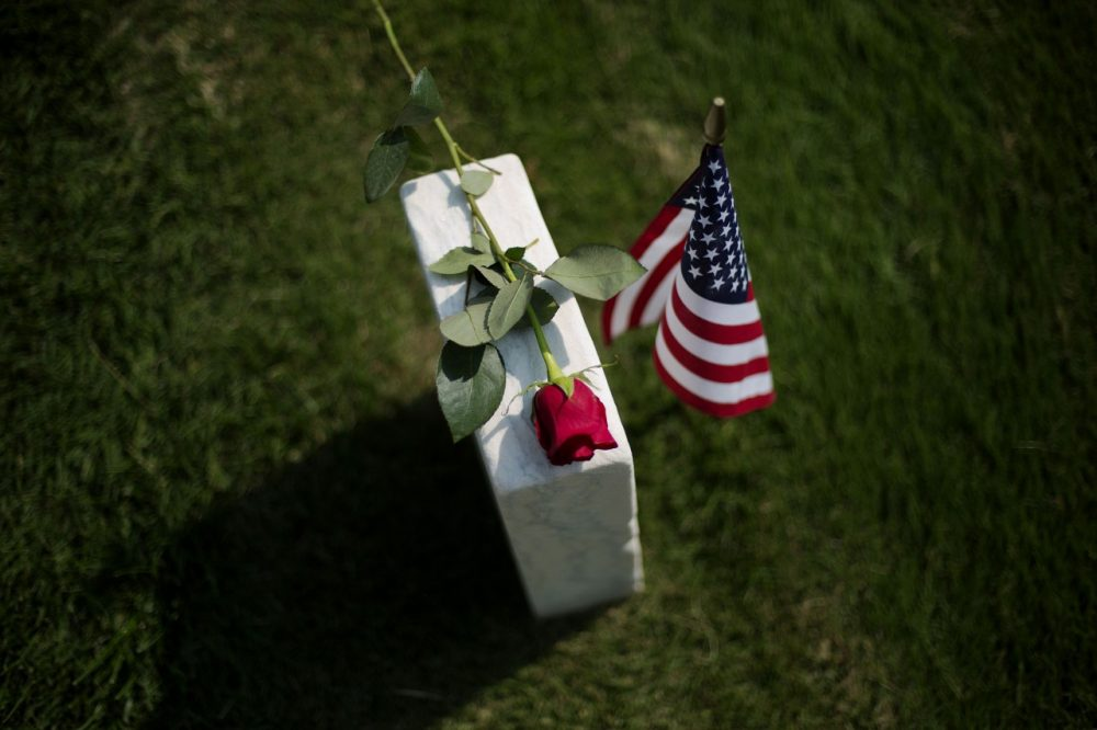 A rose sits on a tombstone of a civl war soldier at Marietta National Cemetery on Memorial Day, Monday, May 26, 2014, in Marietta, Ga. (AP)