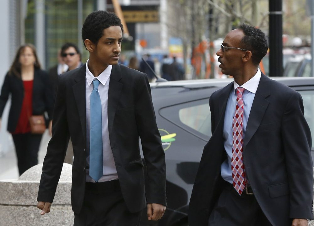 Robel Phillipos, a college friend of Boston Marathon bombing suspect Dzhokhar Tsarnaev, left, arrives at federal court with attorney Derege Demissie, before a hearing Thursday, May 15, 2014, in Boston. Phillipos, of Cambridge, Mass., is charged with lying to investigators after last year's fatal bombing. (AP)