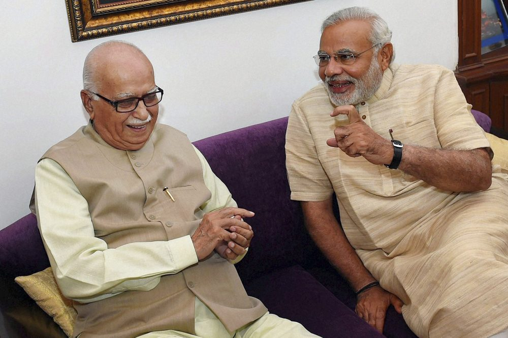 India's next prime minister Narendra Modi, right, talks to Bharatiya Janata Party (BJP) senior leader Lal Krishna Advani at Advani's residence in New Delhi, India, Sunday, May 18, 2014. Results announced Friday from the weeks-long polls showed that Modi and the Hindu nationalist BJP had won the most decisive election victory India has seen in three decades, sweeping the long-dominant Congress party from power. (AP)