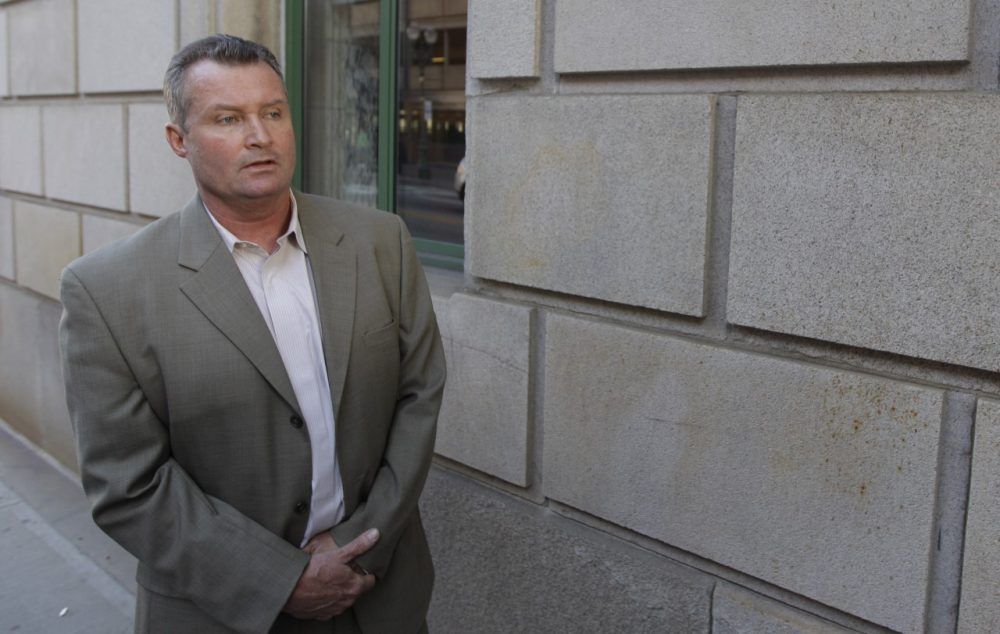 Former Massachusetts probation department commissioner John O'Brien stands outside the Federal Courthouse in Worcester, Mass., in 2012. (Stephan Savoia/AP)
