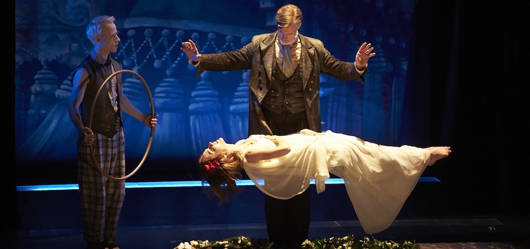 Prospero (Tom Nelis) levitates Miranda (Charlotte Graham) with Ariel (Nate Dendy) providing assistance. (Geri Kodey)
