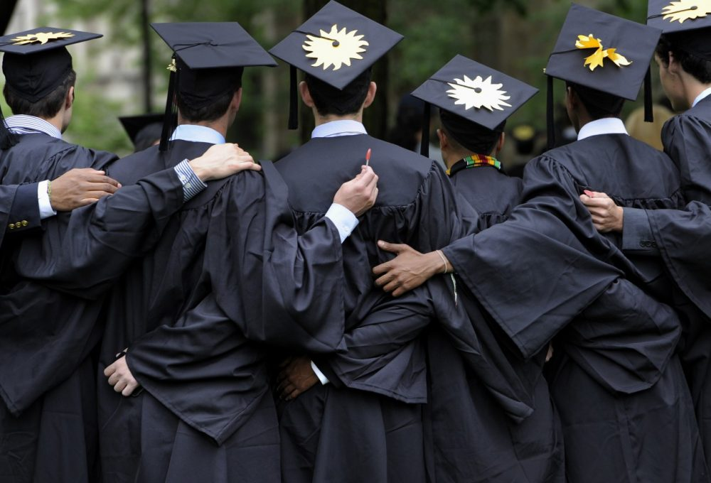 Graduates pose for photographs during commencement at Yale University. (/Jessica Hill/AP)