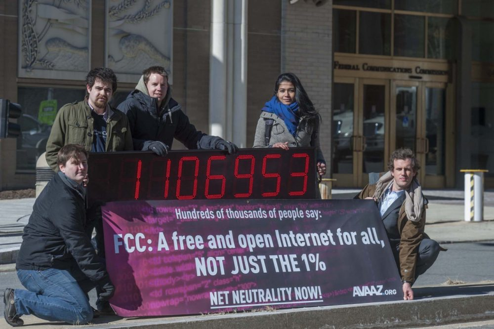 Members of global advocacy group Avaaz stand next to a digital counter showing the number of petition signatures calling for net neutrality outside the Federal Communication Commission in Washington, Thursday, Jan. 30, 2014. Avaaz joined other US advocacy groups to deliver more than a million signatures for a free and democratic internet to the FCC. (AP)
