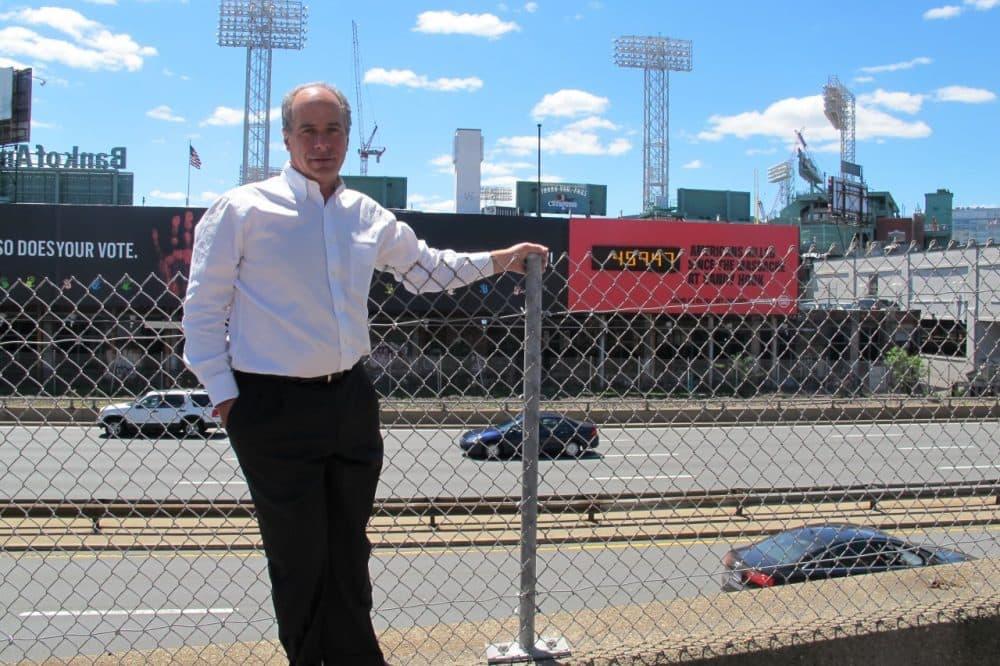 John Rosenthal, co-founder of Stop Handgun Violence, across from his billboard. (Anthony Brooks/WBUR)