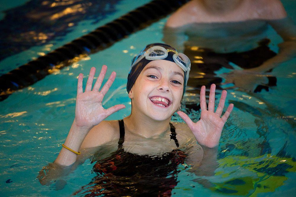 Swimmer Tori Merlino, 9, enjoys swim practice at Bosse Sports in Sudbury, Mass.