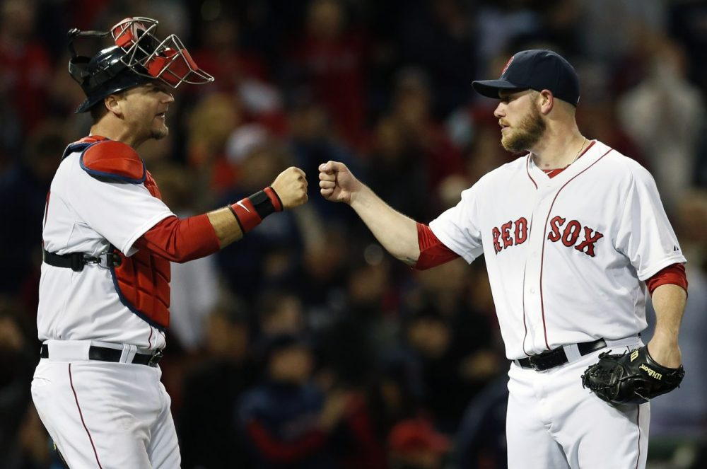 Boston Red Sox's Alex Wilson, right, and A.J. Pierzynski celebrate after they defeated the Tampa Bay Rays 7-1 in a baseball game in Boston, Saturday, May 31, 2014. (Michael Dwyer/AP)