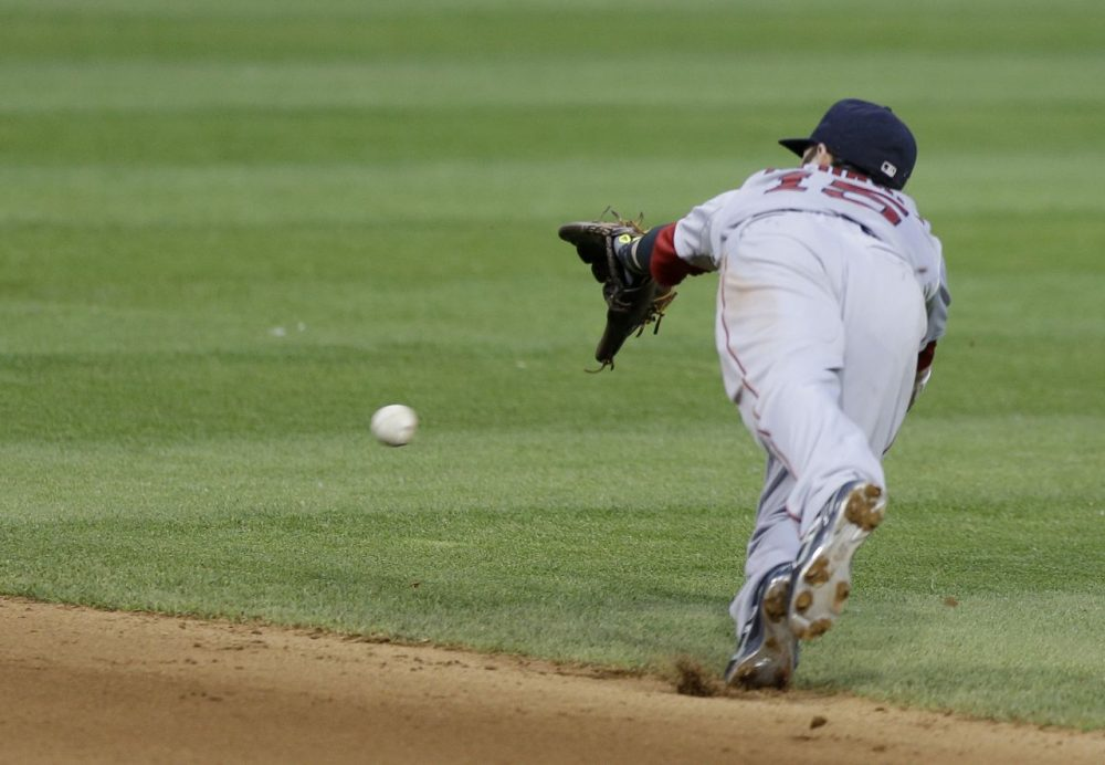 Boston Red Sox's Dustin Pedroia dives but can't get to a single hit by Cleveland Indians' David Murphy. (AP/Tony Dejak)