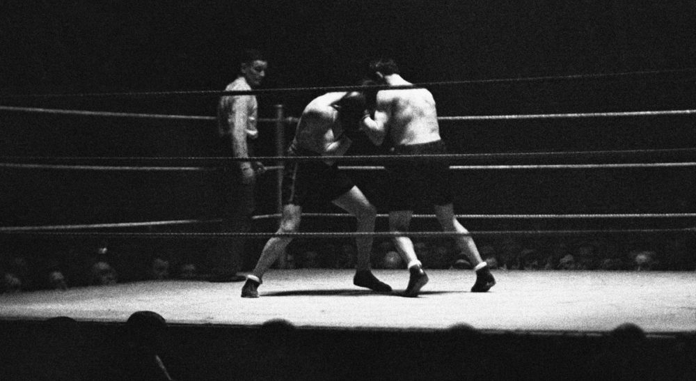 """Theron Tingstad: """"While I don't know if boxing was, on balance, the right thing to do for my mind and body, I do know that it was good for my soul."""" Pictured: A fight at the World Championships at  Albert Hall, London, on Feb. 18, 1930. (AP)"""