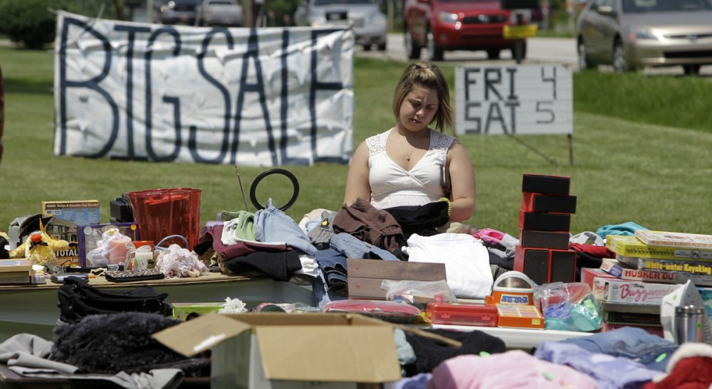 Doreen Vigue: Yard sales are the great equalizer. It's the thrill of the hunt for some, a necessity for others and pure entertainment for all. (Michael Conroy/AP)