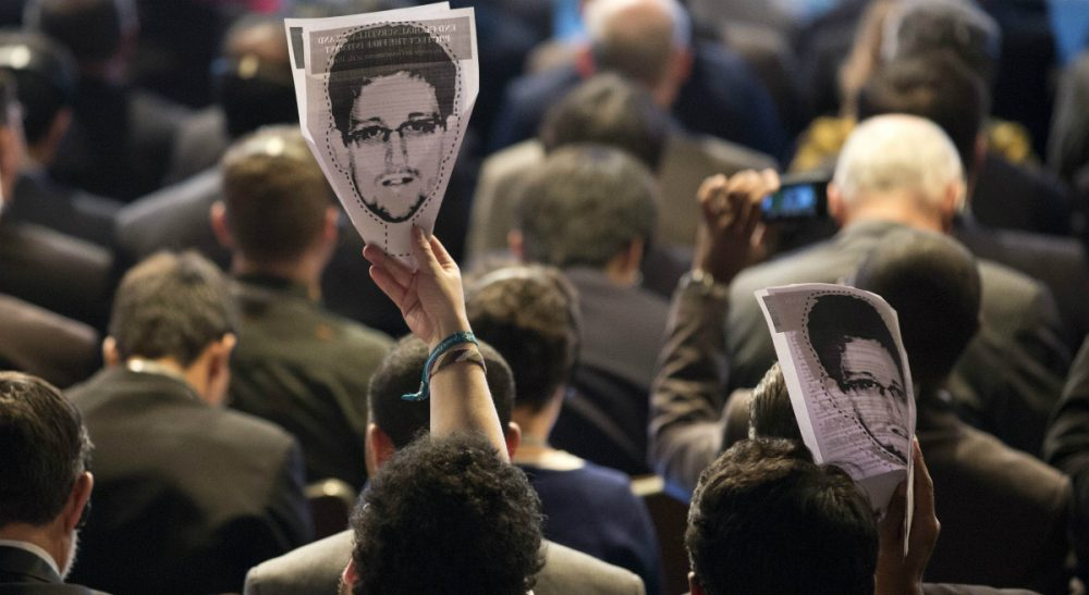 Is former NSA analyst Edward Snowden a 'traitor' who betrayed his country, or a 'whistle-blower' who sparked an important conversation about the limits of surveillance? In this photo, participants hold up images of Snowden during a conference on the future of Internet governance in Sao Paulo, Brazil, Wednesday, April 23, 2014. (Andre Penner/AP)