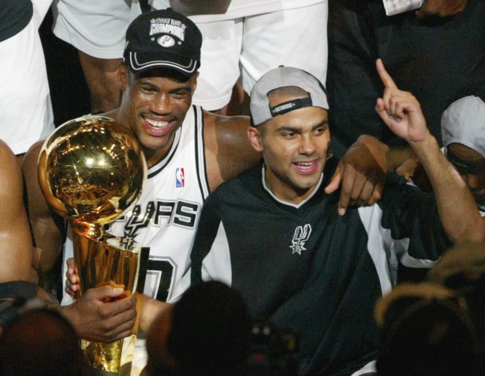 Caption:David Robinson (L) of the San Antonio Spurs and Frenchman Tony Parker celebrate after beating the New Jersey Nets in game six of the NBA Finals at SBC Center in San Antonio, Texas. The Spurs won the game 88-77 to win the best-of-seven game series 4-2. AFP PHOTO/James NIELSEN (Photo credit should read JAMES NIELSEN/AFP/Getty Images)