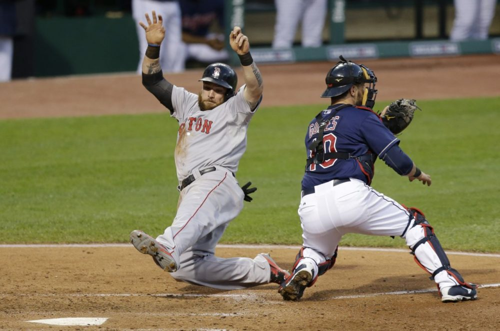 Boston Red Sox's Jonny Gomes, left, scores as Cleveland Indians catcher Yan Gomes waits for the ball in the sixth inning. (AP/Tony Dejak)