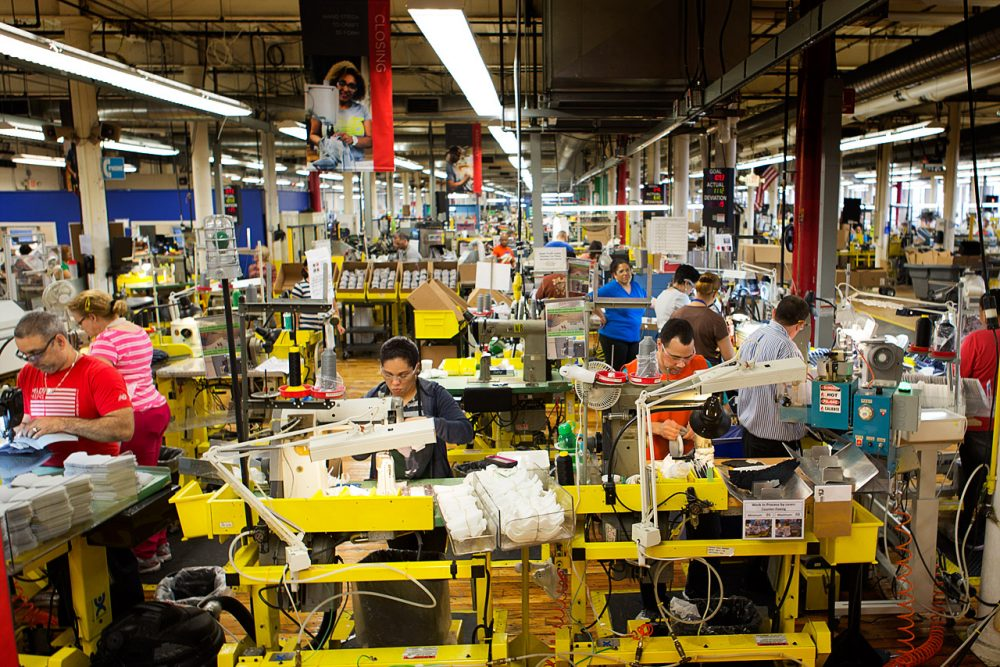 On the New Balance factory floor in Lawrence, the majority of workers are from the city. But it's a different story in the upstairs offices. (Jesse Costa/WBUR)