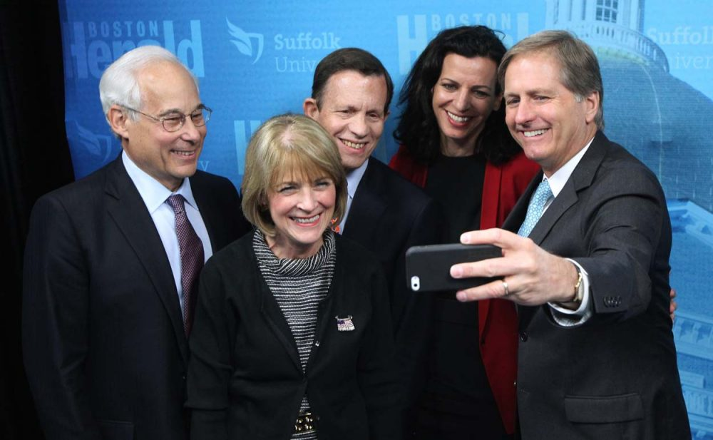 Massachusetts Democratic gubernatorial hopefuls take a group selfie following a debate at Suffolk University Tuesday. From left Don Berwick, Martha Coakley, Steve Grossman, Juliette Kayyem and Joseph Avellone.  (Matt Stone/The Boston Herald/AP/Pool)