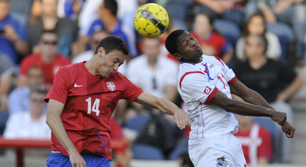 Jeffrey Holt: Every artful touch of the ball, exquisite pass, explosive burst of speed and thundering shot on goal, begins in the cortex of evolution's greatest achievement: the human brain. In this photo, Serbia's Nemanja Matic (14) goes up for a header against Panama's Armando Cooper (11) during the first half of an international friendly soccer game in Bridgeview, Ill., Saturday, May 31, 2014. (Paul Beaty/AP)
